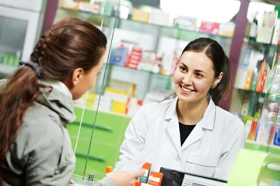 pharmacist smiling at her customer