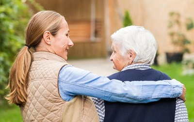 lady hugging a senior woman