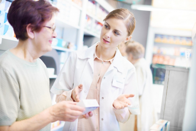pharmacist assisting her customer